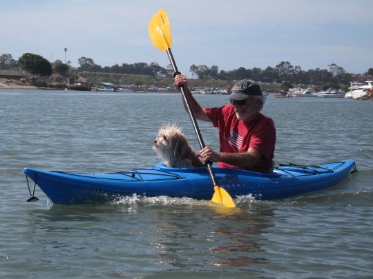 Random kayaker with dog