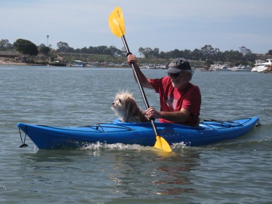 Random kayaker with dog