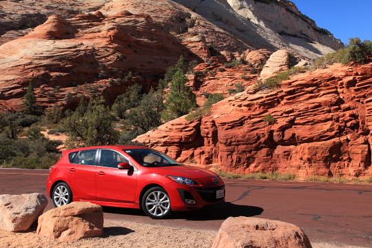 Red rocks behind our red car